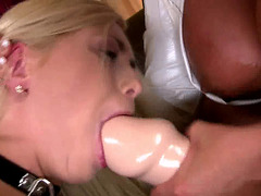 Lovely blonde dominated by a big gal with a huge dildo