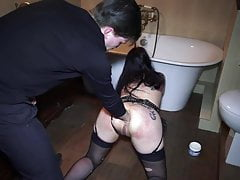 Rough BDSM fisting in toilet room